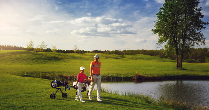 Father & Son On Golf Course