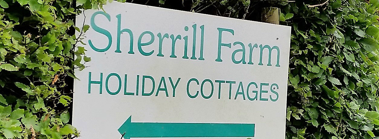Sign for Sherrill Farm Holiday Cottages Devon